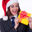 Businesswoman wearing a santa's hat — Stok fotoğraf