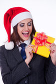Businesswoman wearing a santa's hat — Stock Photo