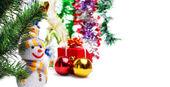 Snögubbe på bakgrund av juldekorationer — Stockfoto