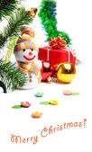 Snowman on the background of Christmas decorations — Stock Photo