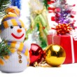 Royalty-Free Stock Photo: Snowman on the background of Christmas decorations