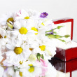 Wedding flowers and ring in box — Stock Photo