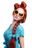Fashion red-haired woman in a stylish glasses — Stock Photo