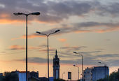 Street lights and bell tower, Milan — Stock Photo