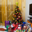 Christmas tree with gift packages - Stock Photo