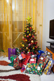 Christmas tree with gift packages — Stock Photo