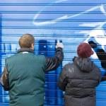 Artists painting a graffiti — Stock Photo #7674163