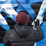 Artists painting a graffiti — Stock Photo