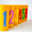 Yellow plastic cans numbered one to six — Stock Photo
