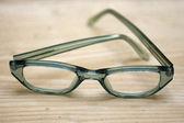 Green eyeglasses — Stock Photo