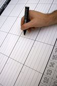 Person writing in a italian planner — Stock Photo