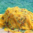 Yellow fishing nets - Stock Photo