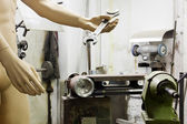 Mannequin in a machine shop — Stock Photo