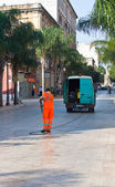 Operator ecologically clean Brindisi street — Stock Photo