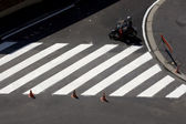 Motorcyclist on the road with pedestrian crossing — Stock Photo