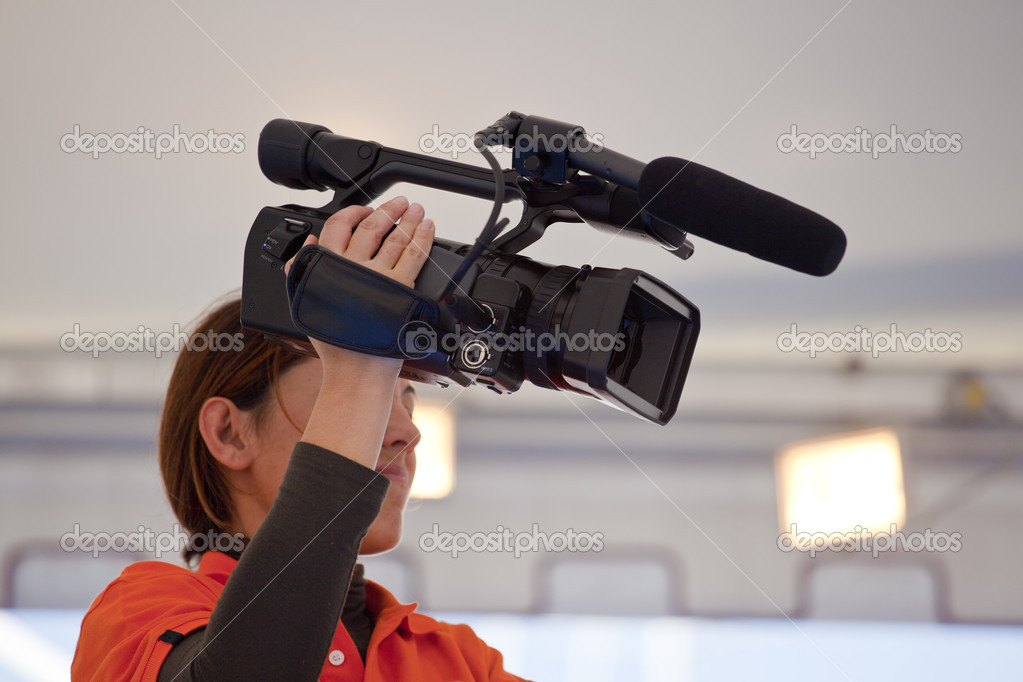 Camera woman recording a movie  Stock Photo #7686186