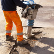 Worker with jackhammer — Stock Photo