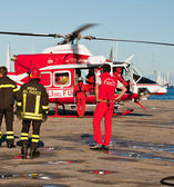 Helicopter and Italian firemans — Stock Photo