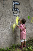 Child painting on the wall — Stock Photo