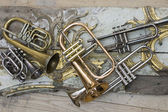 Trumpets on pieces of antique furniture — Stock Photo