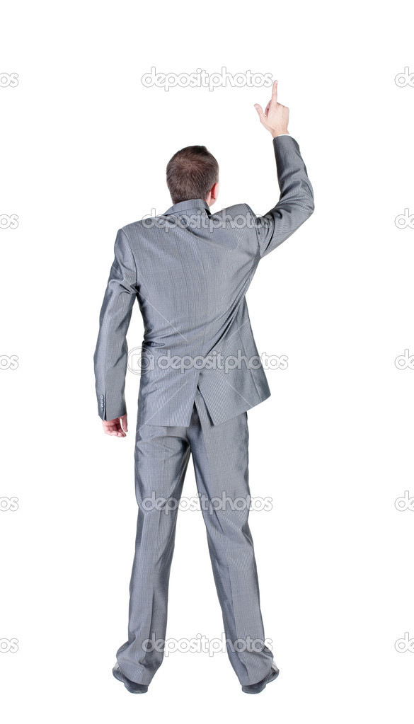 Businessman pointing at wall. rear view. Isolated over white .   Stock Photo #7183334