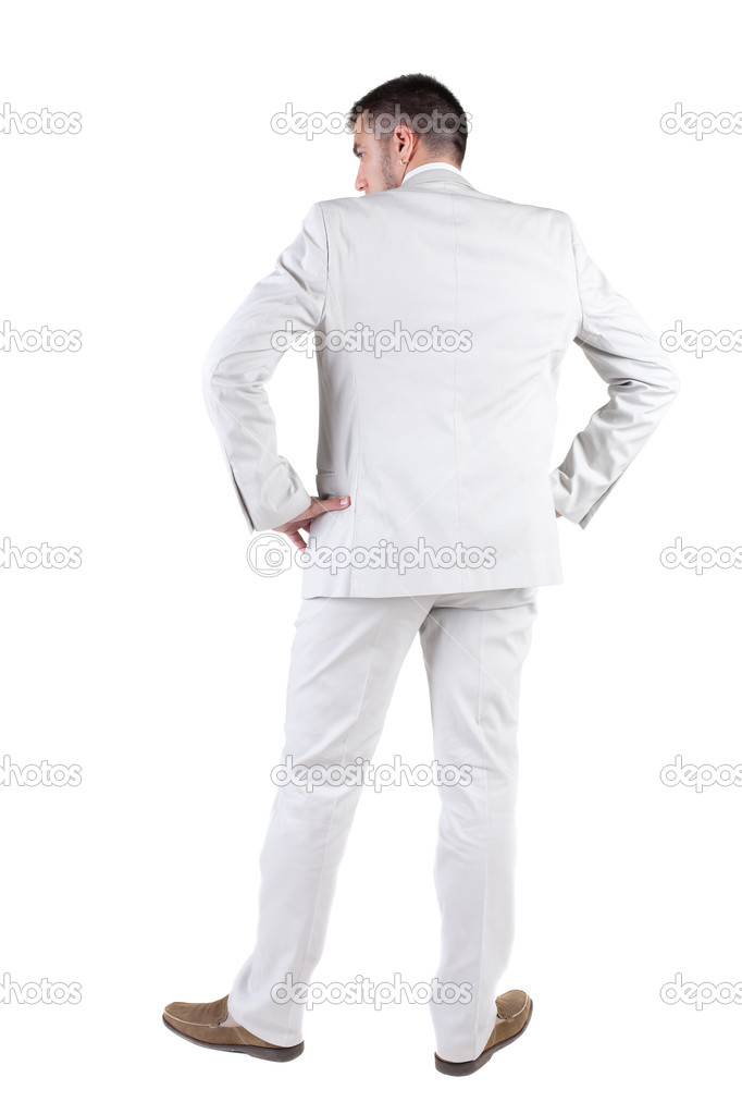 Businessman  looks ahead. rear view. Isolated over white .  — Stock Photo #7183352