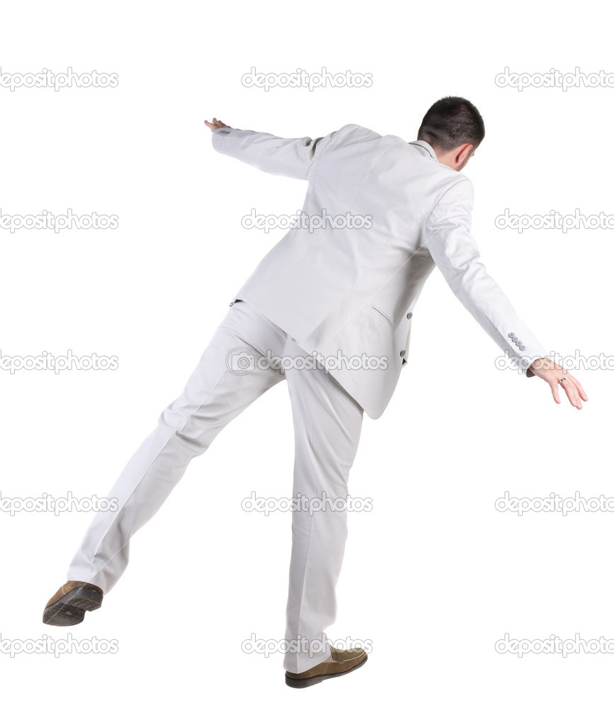 Balancing  businessman  . Rear view. Isolated over white background.  — Stock Photo #7183357