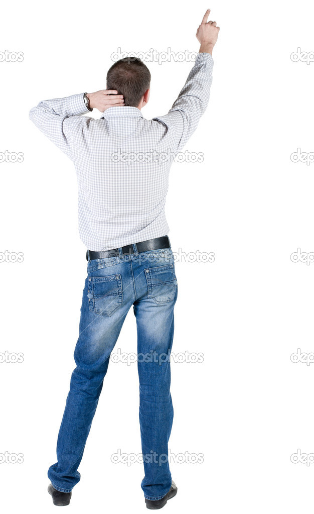 Young man pointing at wall. rear view. Isolated over white . — Stock Photo #7183469