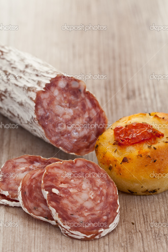 Tasty rustic italian bread with salami — Stock fotografie #6864230