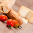 Baguette and tomatoes — Stock Photo #6954323