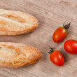 Baguette and tomatoes — Stock Photo
