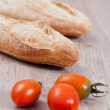 Stock Photo: Baguette and tomatoes