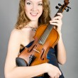 The girl with a violin — Stock Photo #7798924