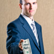 A man in a suit with money — Stock Photo