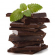 Chocolate bars stack and mint leaf — Stock Photo #7011880