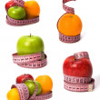 Foto Stock: Tape measure wrapped around fruits isolated on white background