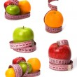 Tape measure wrapped around fruits isolated on white background — Stock Photo