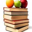 Stock Photo: Book stack with fruits isolated on white background
