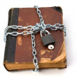 Stock Photo: Tattered book with chain and padlock