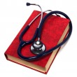 Stethoscope on red book isolated on white background — Stock Photo #7018013
