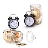 Money accumulation concept. Money and alarm clock isolated on wh — Stock Photo