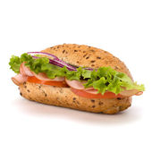 Fast food baguette sandwich with lettuce, tomato, ham and chees — Stock Photo