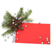 Christmas decoration with greeting card isolated — Stock Photo