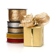 Festive gift box and wrapping ribbons isolated on white backgrou — Stock Photo