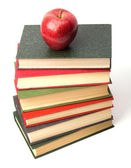 Book stack with apple isolated on white background — Stock Photo