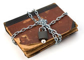 Tattered book with chain and padlock — Stok fotoğraf