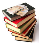 Money over book stack. Education concept — Stock Photo
