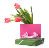 Gift with pink tulips — Stock Photo