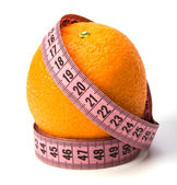 Tape measure wrapped around the orange isolated on white backgr — Stock Photo