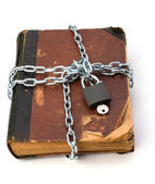 Tattered book with chain and padlock — Stock Photo